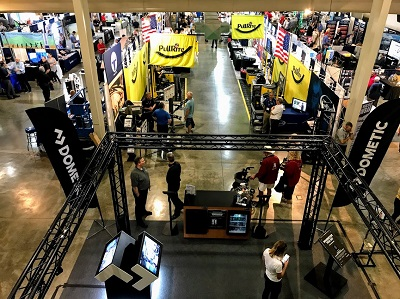 A photo taked from above showing people milling around booths at the RV/MH Hall of Fame Supplier Show