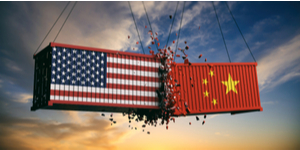 A picture of two shipping containers crashing into each other. One shipping container has the American flag painted on it. The other has the Chinese flag painted on it.