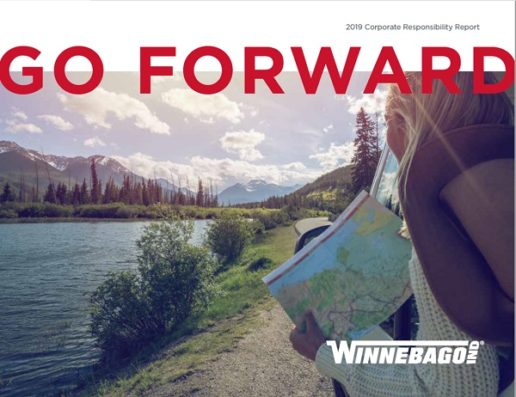 """The front cover of Winnebago's corporate responsibility report, which shows a photo of two women looking at a map as they stand beside a wide river with mountains in the background. The words """"Go Forward"""" are superimposed on the top of the image."""