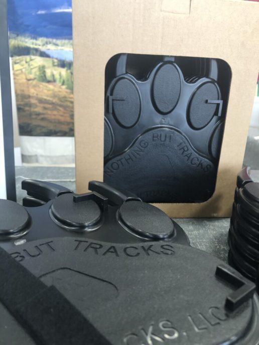 a six-pack of Jack Tracks bear-claw-shaped RV jack pads.