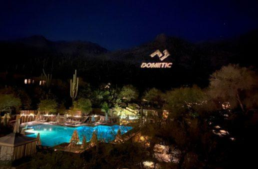 Dometic's logo is projected onto the Catalina Mountains during the opening night of Dometic in the Desert.