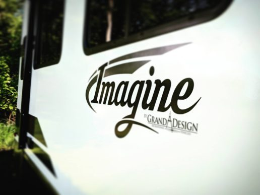 A photo of the Grand Design logo on the side of an Imagine RV