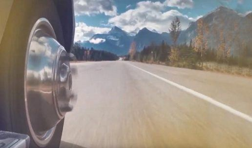 Close-up view of RV wheels rolling down mountain highway