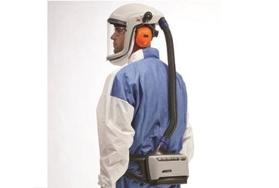 A picture of a man wearing a 3M Powered Air Purifying Respirator