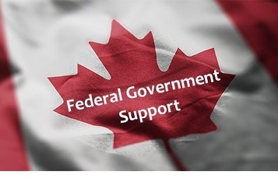 "A picture of the maple leaf in the center of the Canadian flag with the words ""Federal Government Support"" on it"