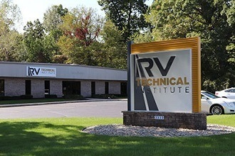 A photo of the RV Technical Institute building with the sign out front