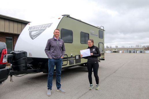 A photo of Warrior Expeditions receiving a donated Winnebago RV