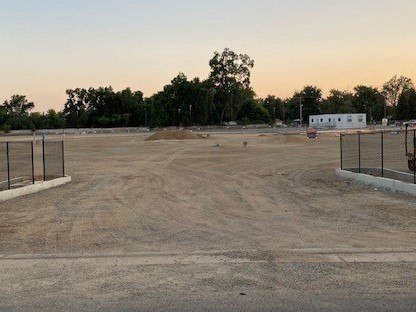 A picture of a vast, empty gravel lot