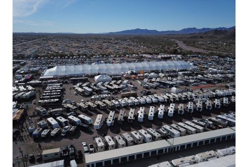 Am aerial photo of the Quartzsite Sports Vacation RV Show, showing dozens and dozens of RVs lined up and parked on a giant lot