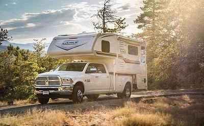 truck camper in forest