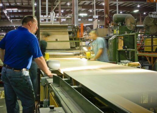 workers manufacture plywood at a patrick industries facility