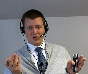 A picture of Jered Sobel from Sobel University speaking by headphone