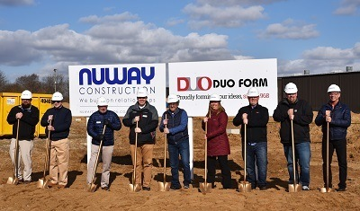A picture of Duo Form's staff breaking ground an expanded warehouse
