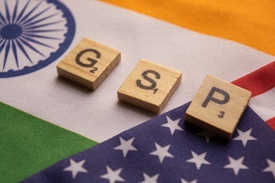 A picture of GSP letters standing for Generalized System of Preferences laid out on flags