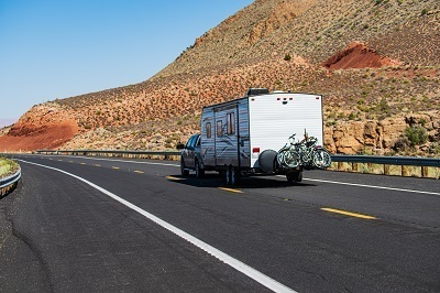A picture of an RV driving along a Texas road