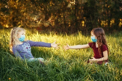 A picture of kids wearing masks outside