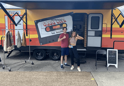 A picture of artist Kip Moore outside a Dutchmen RV photo booth for his music tour