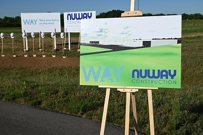 A picture of a Nuway Construction sign at the Way groundbreaking event