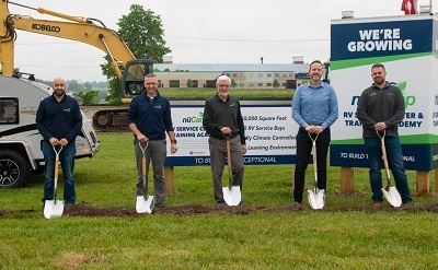 A picture of nuCamp breaking ground on a new service facility