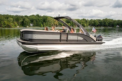 A picture of a family riding in a Barletta pontoon boat. Winnebago announced it is buying Barletta.