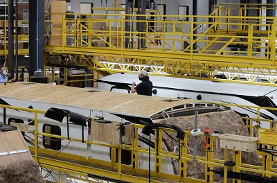 A picture of RVs being manufactured at a Cruiser RV plant. Cruiser RV is a division of Heartland RV.