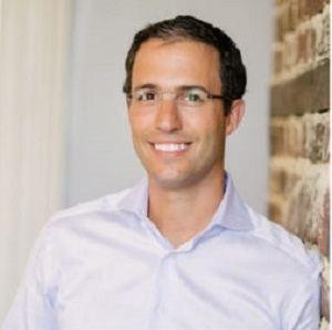 A headshot of PureCars CEO Jeremy Anspach