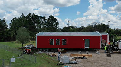 A side view of the little red school house being built on the NRVTA campus in Texas to house training classes.