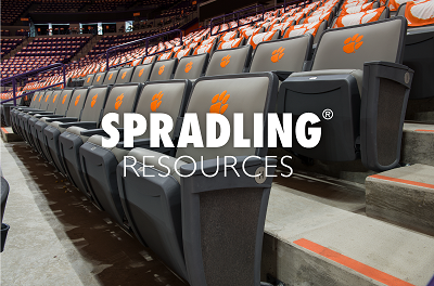 A picture of the Spradling Resources name over a row of stadium vinyl seats with the Clemson orange paw logo on their backs