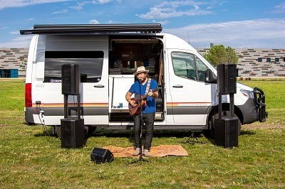 A picture of the Volta Power Systems energy used to power an outdoor concert from a Mode campervan