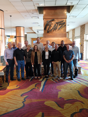 A picture of RVIA and other campground industry association leaders gathered in a meeting in Colorado