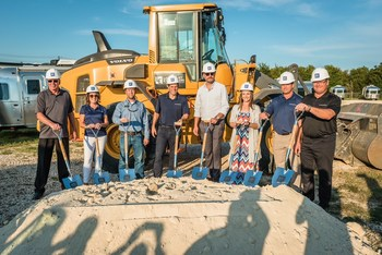 A picture of RV Retailer officials in front of a tractor ready to break ground on a Texas dealership site in Buda.