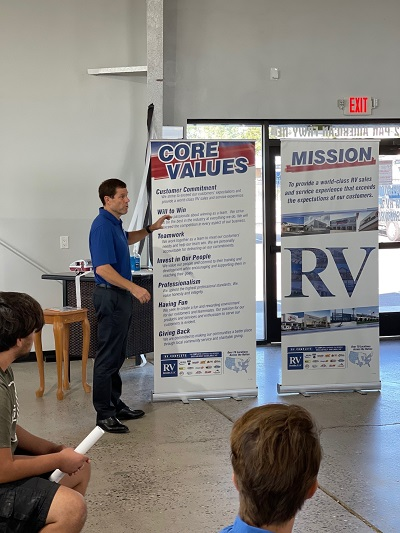 A picture of RV Retailer President and CEO Jon Ferrando discussing the company's values to new Aloha RV employees